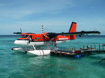 Red seaplane anchoring Stock Image