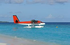 Red seaplane at the beach Stock Photos