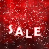 Red seasonal sale sign hanging on strings Stock Photo