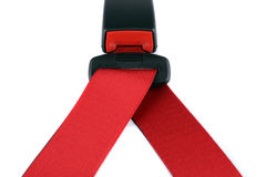 Red seat belt clasped on the lock Stock Photography