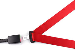 Red seat belt with a fastener and the lock. Isolated on the white background stock photos