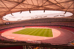 Red seat  and green field in National Stadium,Beijing,China on 22 May 2013 Royalty Free Stock Image