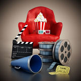 Red seat, pop corn, film reel and slate. 3D illustration. Red seat, pop corn, ticket, film reel and slate. 3D illustration Stock Photos