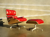 Red seat to layer concrete wall Royalty Free Stock Image