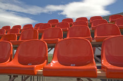 Red seats. Red seats on a background of the sky with clouds Stock Photography