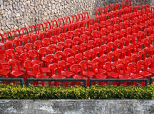 Red seats. Empty red chairs aligned in rows Stock Photos
