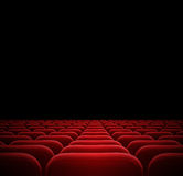 Red seats in dark cinema. Theater Royalty Free Stock Photo