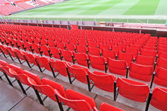 Red seats at football stadium. Red seats in football club stadium of Manchester United, England Stock Photo