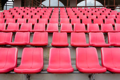 Red seats in football stadium Royalty Free Stock Photos