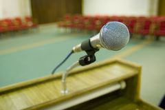Red seats and microphone royalty free stock photo
