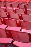 Red seats outdoors Royalty Free Stock Images