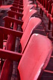 Red seats outdoors Stock Images