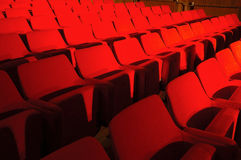 Red seats in public hall Stock Photo