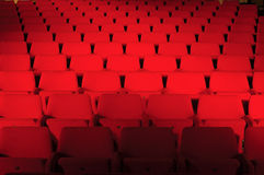Red seats in public hall Stock Image