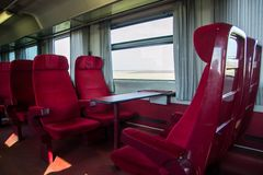 Red seats in a railcar Stock Photos