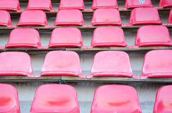 Red seats at soccer sports stadium Royalty Free Stock Image