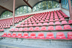 Red seats at soccer sports stadium Stock Photo