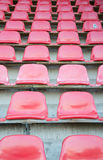 Red seats at soccer sports stadium Royalty Free Stock Photos