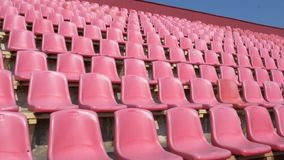 Red seats for spectators in the stadium