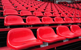 Red seats in a stadium Royalty Free Stock Photo