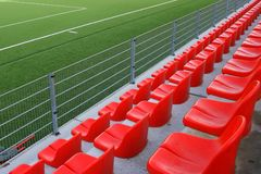 Red seats on the stadium. Empty, red seats on football stadium Royalty Free Stock Photography