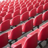 Red seats in the stadium. Empty seat of football stadium stock photography