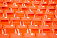 Red seats on stadium steps bleacher Stock Image
