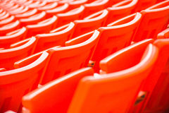Red seats on stadium steps bleacher Royalty Free Stock Photo