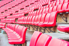 Red seats on stadium steps bleacher Royalty Free Stock Images