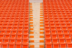 Red seats on stadium steps bleacher Stock Images