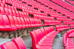 Red seats on stadium steps bleacher Royalty Free Stock Image