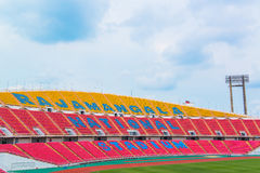 Red seats on stadium steps bleacher Royalty Free Stock Photos