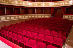 Red seats in theater Stock Photography