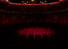 Red seats in a theater. Follow spot on red seat in a generic theater Royalty Free Stock Images