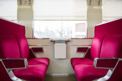 Red seats on the trains. Blank Stock Photos