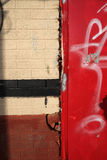 Red security door damaged during a break in Royalty Free Stock Photo