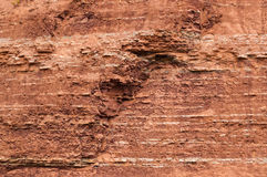 Red sedimentary clay background eroding Royalty Free Stock Photo