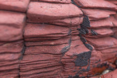 Red sedimentary Rock .Hung Shek Mun,Hong Kong Royalty Free Stock Photography