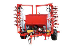 Red seeder. Red modern seeder separately on a white background Stock Images