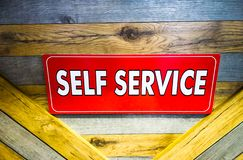 red self service board on the wooden platform royalty free stock photo