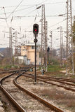 Red semaphore and railway tracks. Traffic light shows red signal on railway Stock Photo