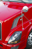 Red semi truck hood, head light,mirror and wheel Royalty Free Stock Photos