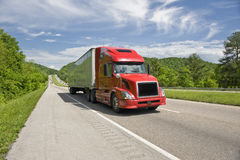 Red Semi Truck On Interstate In Springtime Royalty Free Stock Images
