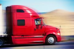 Red Semi Truck on the Road. Semi Truck Tractor Closeup. American Road Transportation Royalty Free Stock Image