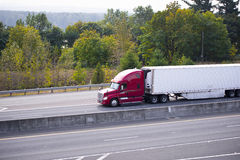 Red Semi Truck Trailer Reefer On Green Highway Royalty Free Stock Images