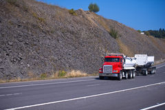 Red semi truck and two trailers on high way Royalty Free Stock Photo