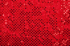 Red sequins pattern. Sparkling sequins background. Stock Image