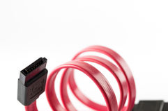 Red Serial-ATA cable isolate. Connection stock image