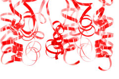 Red serpentine streamers hanging on white. Background stock photo