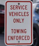 Red service vehicles only sign stock image
